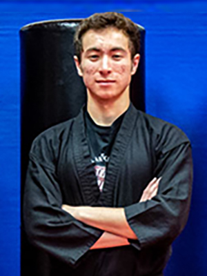 Total Impact Martial Arts - About - Sensei Allen Khomutov - Serving Arlington Heights & Buffalo Grove