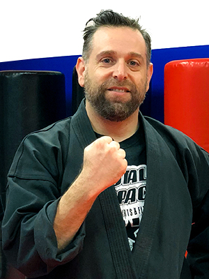 Total Impact Martial Arts - About - Shihan Briam Baim - Serving Arlington Heights & Buffalo Grove
